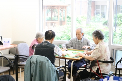 SPLC clients sit in on a sunny day and play Machet
