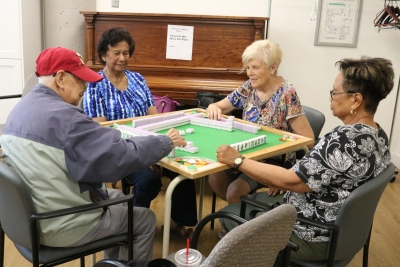 SPLC clients, Isha, Barb, and Yvone play Machet with Jackie